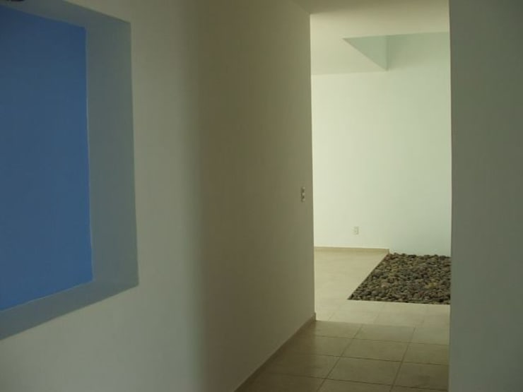 Casa Palomar: Pasillos y recibidores de estilo  por Bojorquez Arquitectos SA de CV