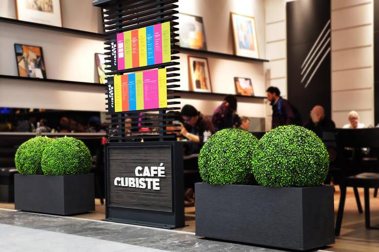 Decoración Muros Verdes: Oficinas y tiendas de estilo  por Ranka Follaje Sintético