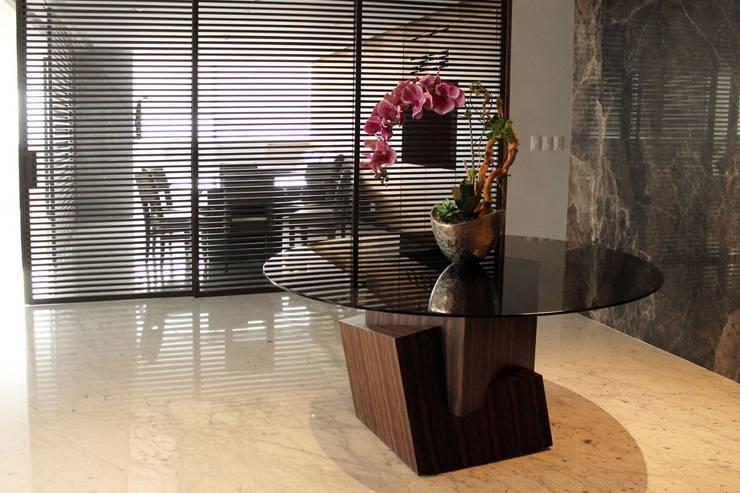 Departamento RK: Pasillos y recibidores de estilo  por Concepto Taller de Arquitectura