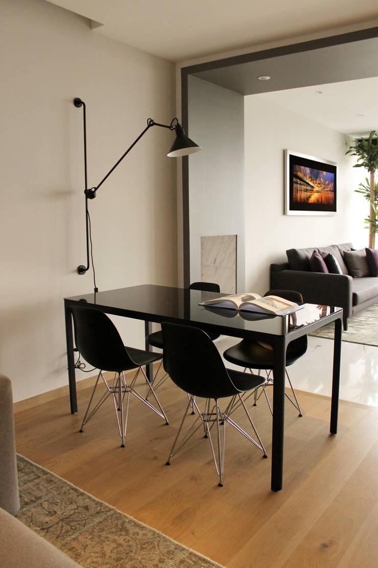 Departamento GD: Comedores de estilo  por Concepto Taller de Arquitectura
