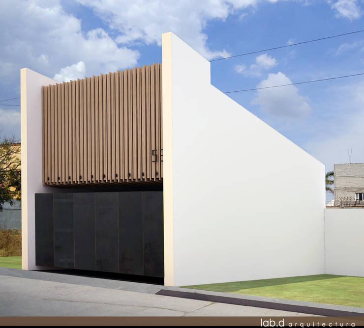 CASA CUBE: Casas de estilo  por lab d arquitectura