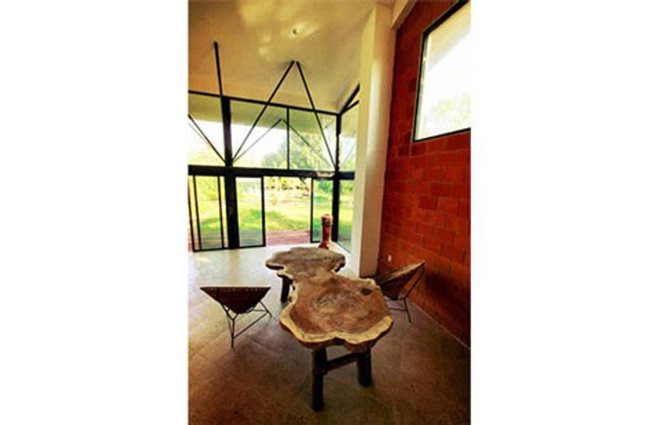 Sala - comedor: Casas de estilo  por PRISMA ARQUITECTOS
