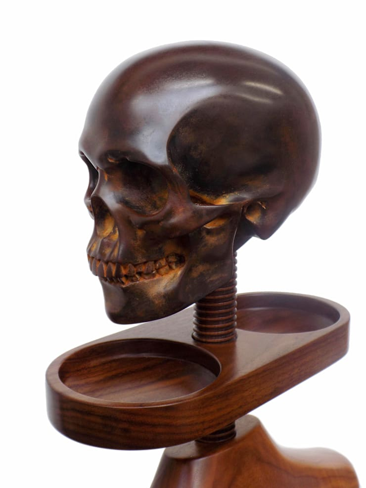 Detail of double bowl accessory tray on a walnut Hatstand Valet wit a dark bronze skull hat rest:  Bedroom by Gentleman's Valet Company