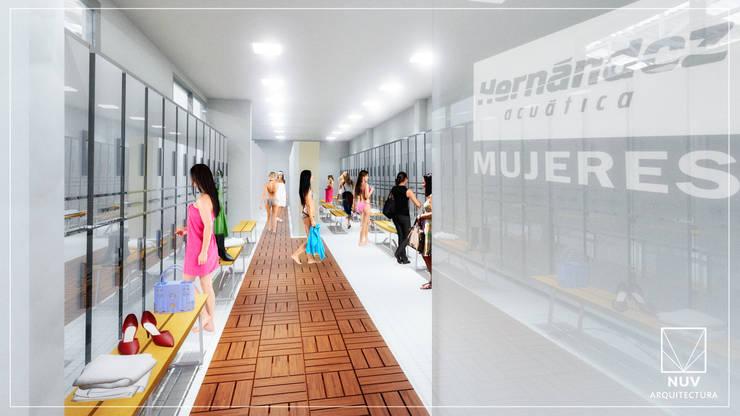 Vestidor de Mujeres: Escuelas de estilo  por NUV Arquitectura