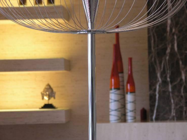 Apartamento Olhos de àgua 2004: Salas de estar  por Atelier  Ana Leonor Rocha