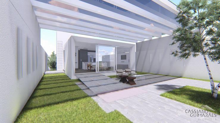 Casas de estilo  por Cassiano Guimarães - arquiteto