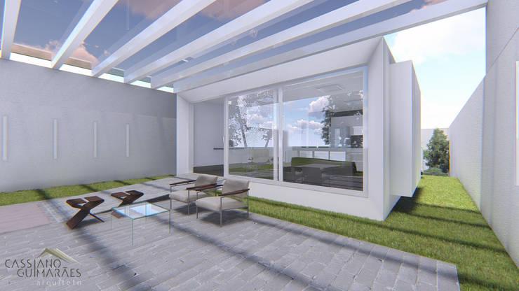 Casas de estilo minimalista por Cassiano Guimarães - arquiteto