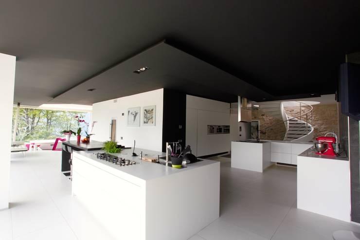 Cozinhas modernas por Mangodesign
