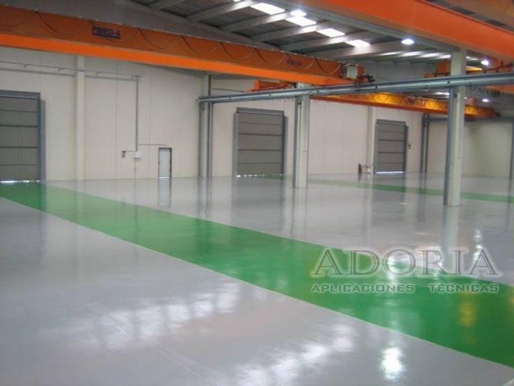 Piso Epoxico Almacen Centros comerciales de estilo industrial de Adoria Aplicaciones Técnicas Industrial