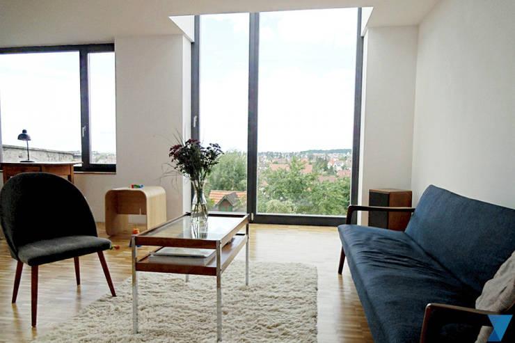 Haus FTS:  Wohnzimmer von yohoco - Eure Architekten