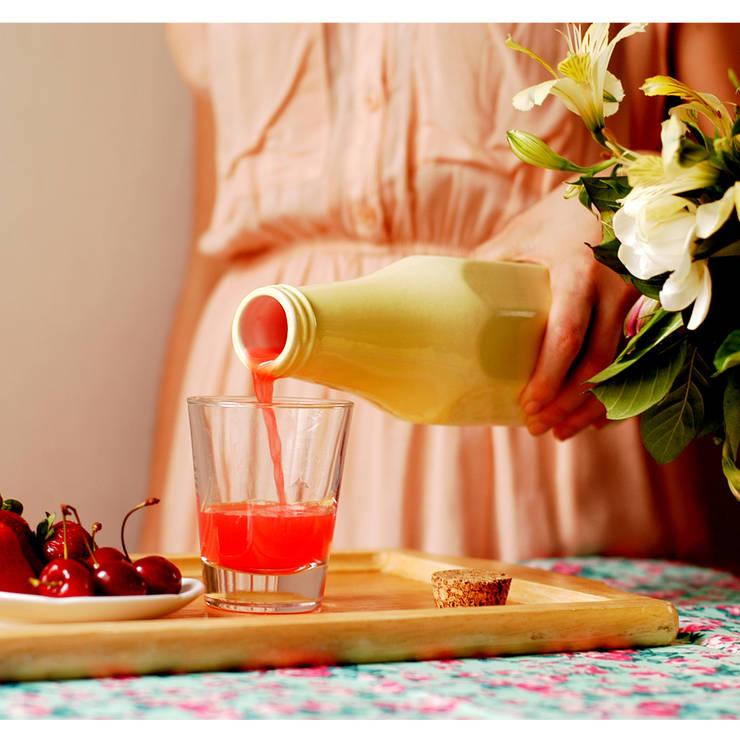 Botella Rosqueta: Hogar de estilo  por Bizcocho