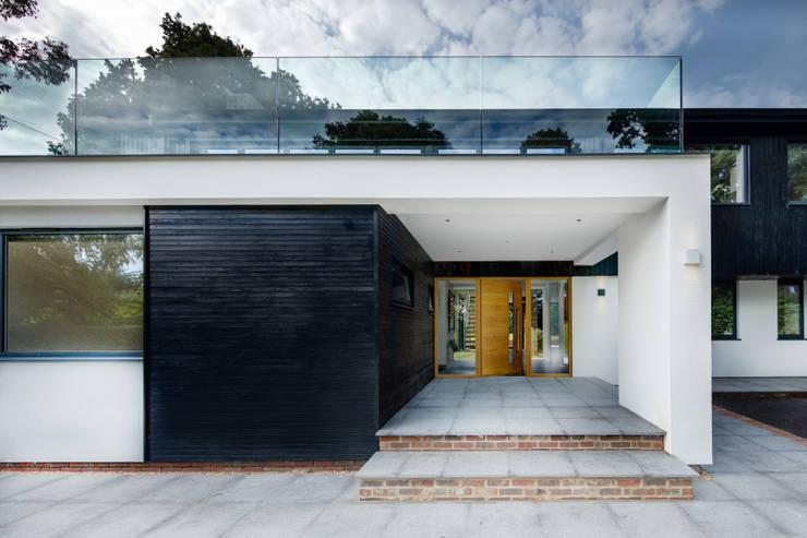 Casas de estilo  por Re-Format LLP