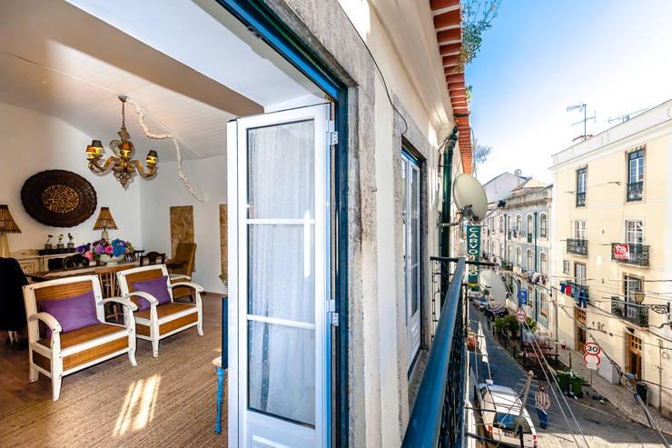 Um apartamento com um toque descontraído de campo em plena cidade.: Casas campestres por alma portuguesa