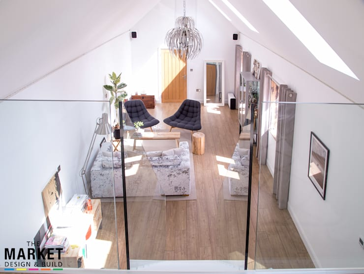 Vital extra space from a cool mezzanine : modern Living room by The Market Design & Build