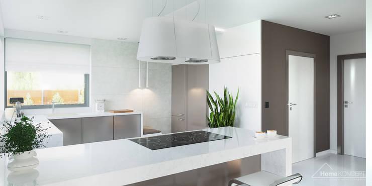 Cocinas de estilo moderno por HomeKONCEPT | Projekty Domów Nowoczesnych