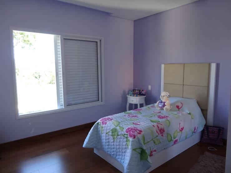 Casa SN: Quarto infantil  por Lozí - Projeto e Obra