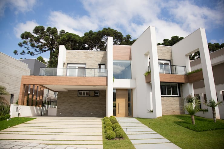 Casas de estilo moderno por Sakaguti Arquitetos Associados