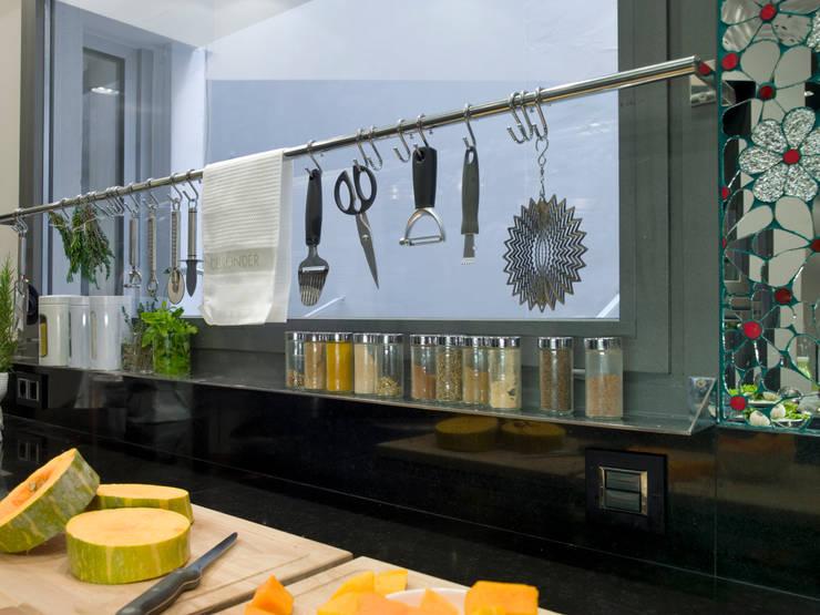 Organización exterior: Cocinas de estilo  de DEULONDER arquitectura domestica