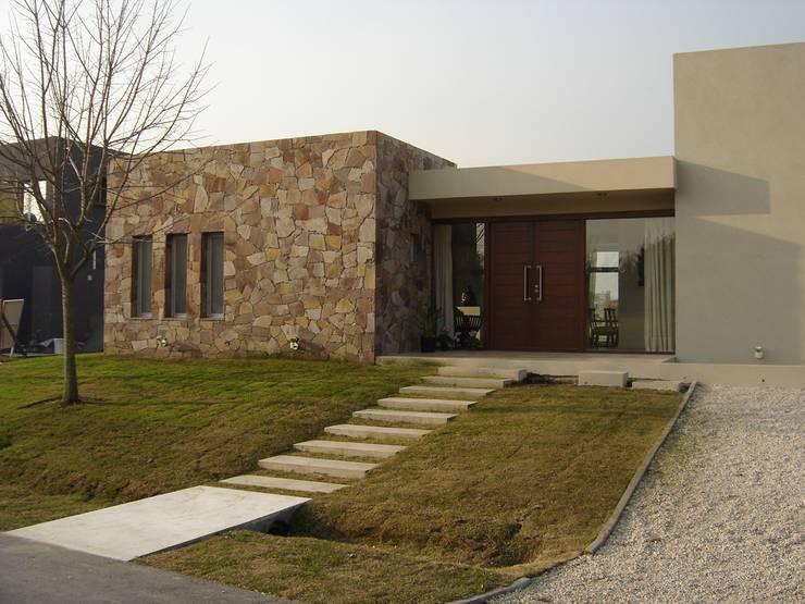 Casa laguna del Sol: Casas de estilo  por Estudio Damiani