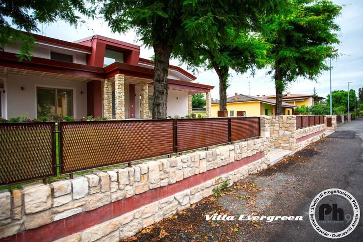 Villa Evergreen: Case in stile in stile Moderno di Studio Ph09 (progress house)
