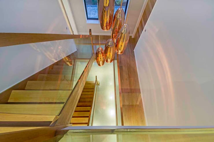 Hadley Wood—North London Modern corridor, hallway & stairs by New Images Architects Modern
