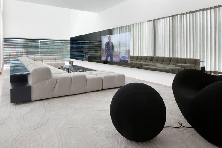 Sala Social: Salas de estar  por GAVINHO Architecture & Interiors