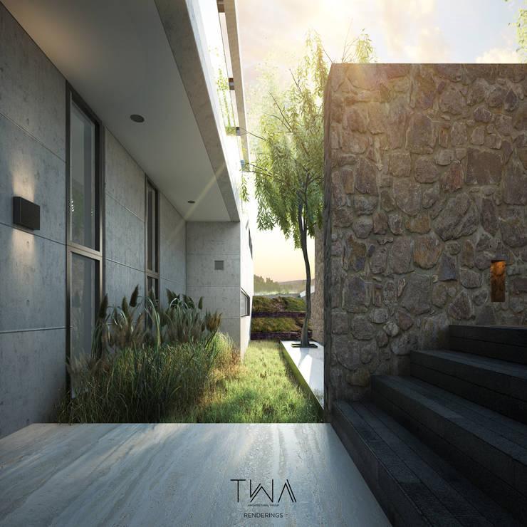 Acceso/Jardín frontal: Jardines de estilo  por TW/A Architectural Group