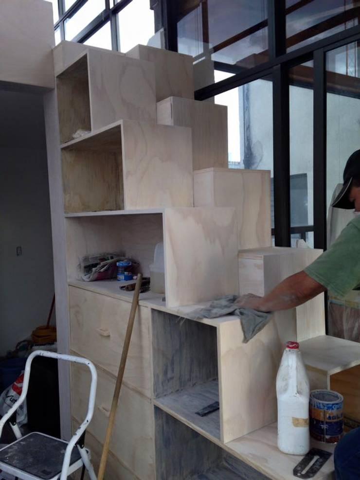 Escalera librero by l g arquitectos homify for Librero escalera