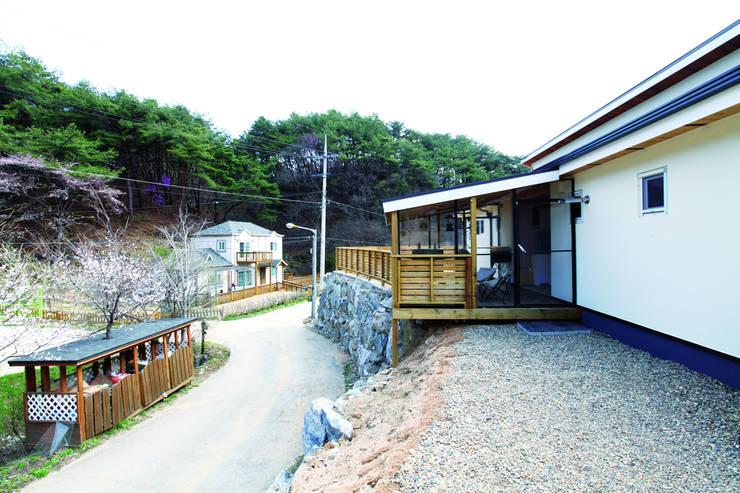 modern Houses by 춘건축