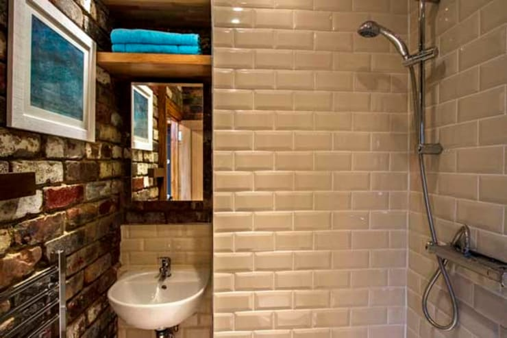 Loft & Extension, Raynes Park: modern Bathroom by Cube Lofts