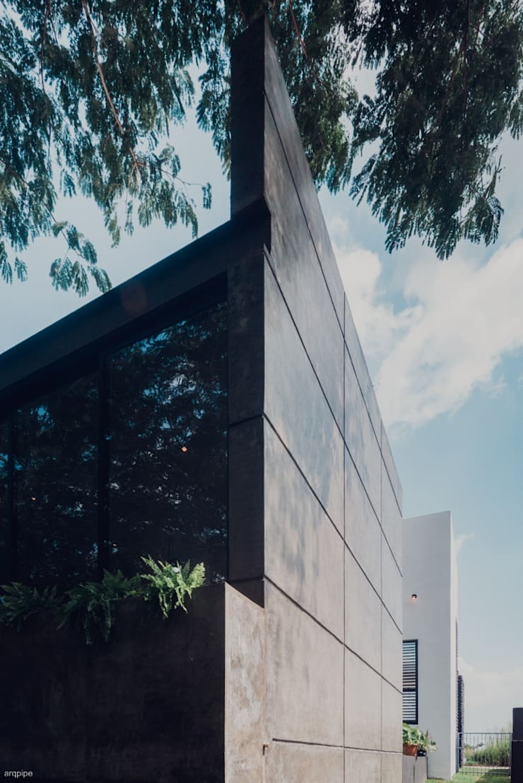 CASA ALTOZANO: Casas de estilo  por ROKA Arquitectos