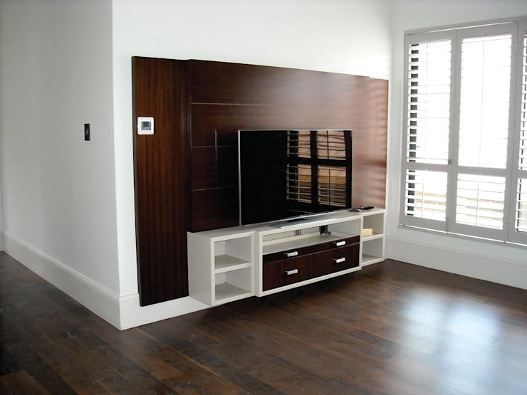 Structural & Interior Architecture Projects: eclectic Media room by CKW Lifestyle