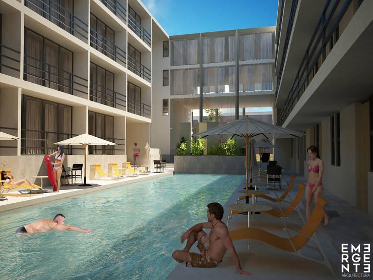 ALBERCA PRINCIPAL: Hoteles de estilo  por EMERGENTE   Arquitectura
