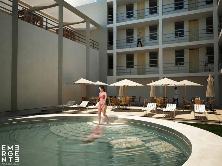 ALBERCA TERMAL: Hoteles de estilo  por EMERGENTE   Arquitectura