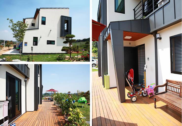 시원한 공간감이 세련된 느낌을 주는 모던 스타일[충남 아산]: 지성하우징의  주택,모던