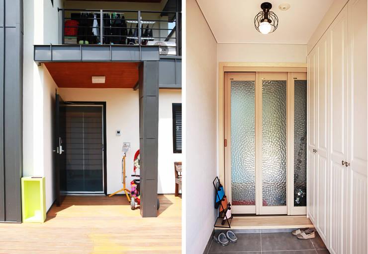 시원한 공간감이 세련된 느낌을 주는 모던 스타일[충남 아산]: 지성하우징의  복도 & 현관,모던