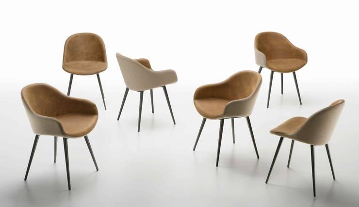Cadeiras modernas Modern chairs www.intense-mobiliario.com  YNNOS PB-Q: Sala de jantar  por Intense mobiliário e interiores;