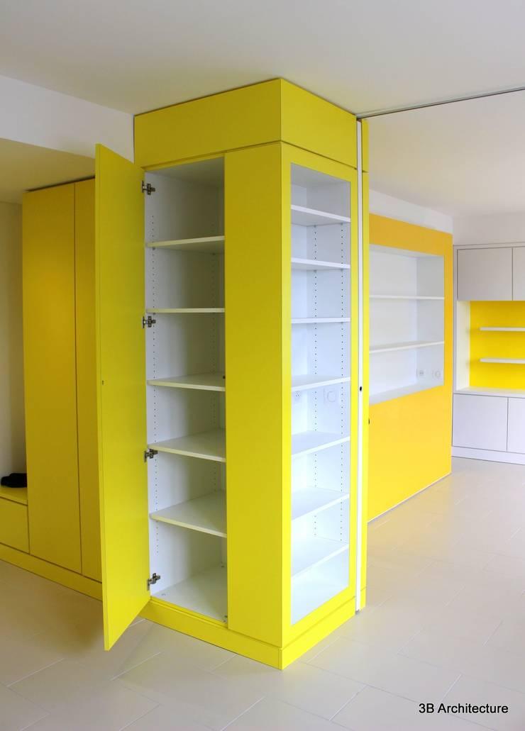 Chaque partie des mobiliers est exploitée pour un usage spécifique.: Dressing de style  par 3B Architecture