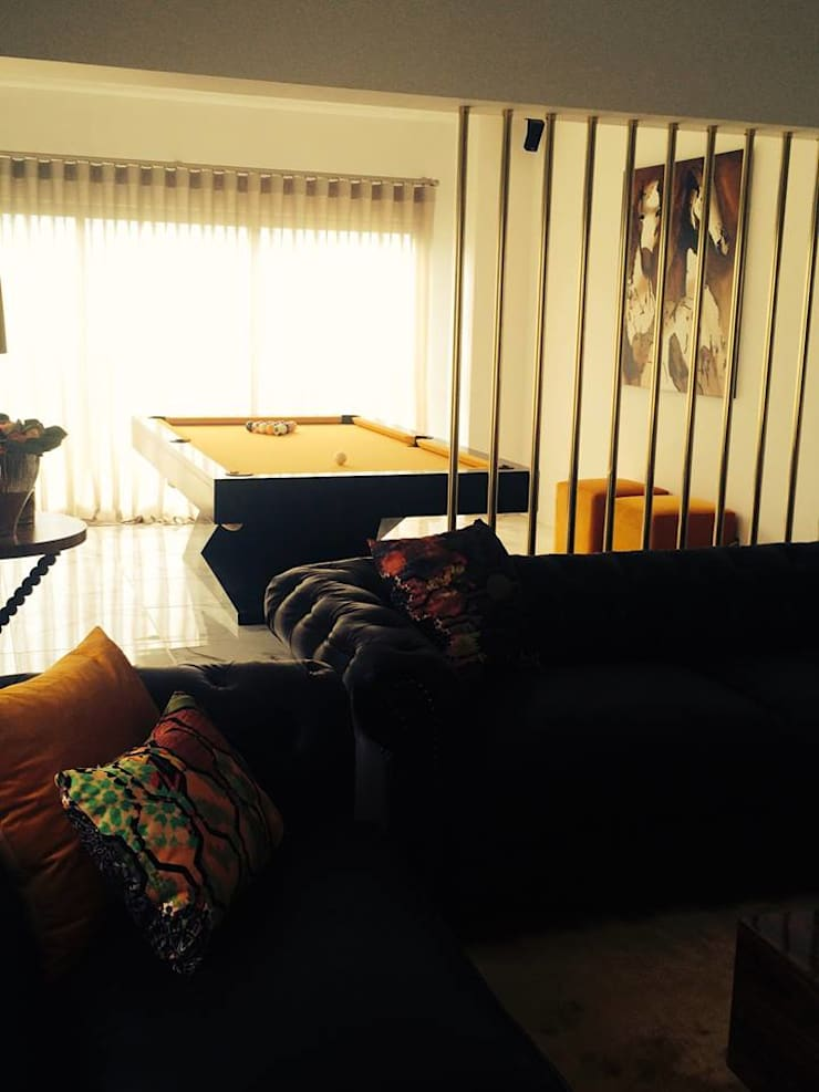 Moradia em Luanda: Salas de estar  por Lili Miranda-Designer de Interiores