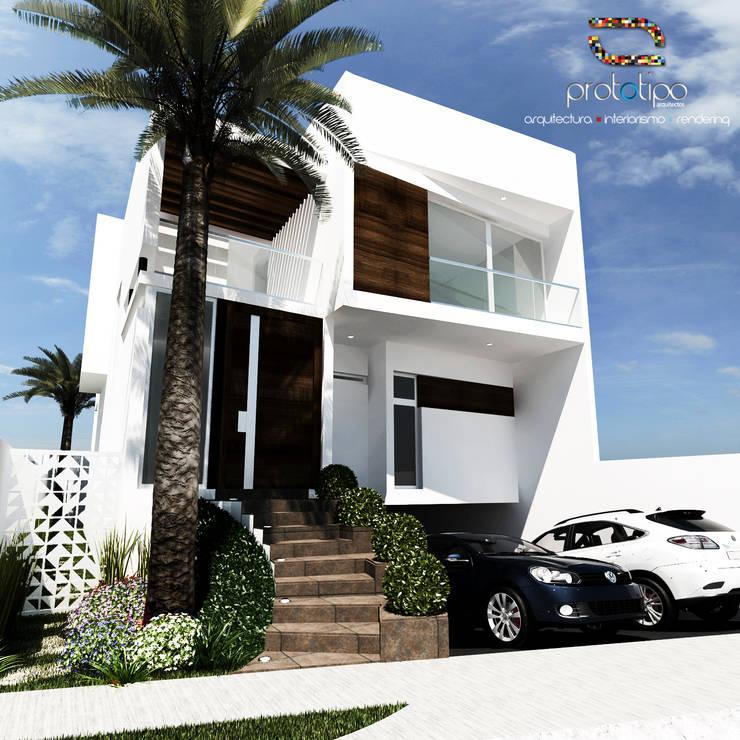 Fachada Casa 57 Casa Fuerte: Casas de estilo  por Prototipo Arquitectos