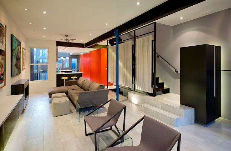 Living room by KUBE Architecture