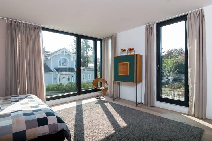 Dormitorios de estilo  por WSM ARCHITEKTEN
