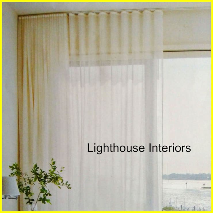 Wave ripple curtains:  Living room by Lighthouse Interiors