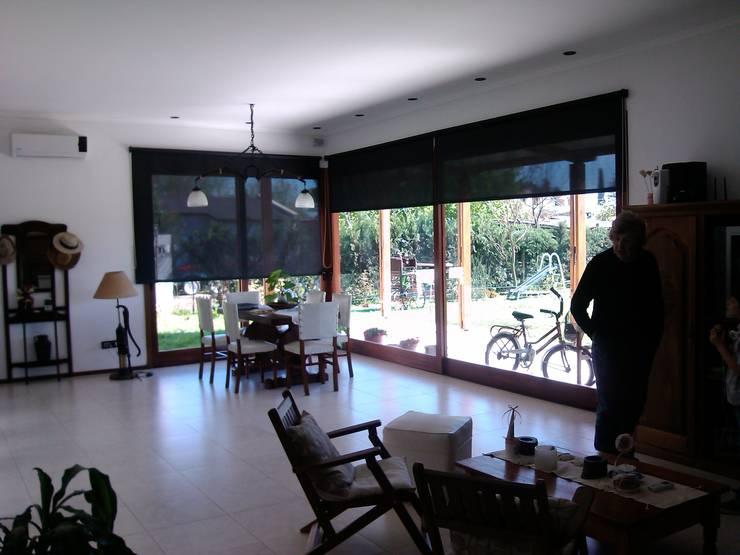 Una Casa + Pancho: Casas de estilo  por Marcelo Manzán Arquitecto,