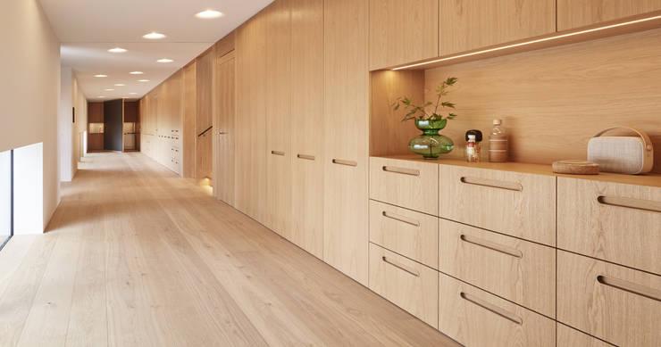 Projekty,  Korytarz, przedpokój zaprojektowane przez Bau-Fritz GmbH & Co. KG