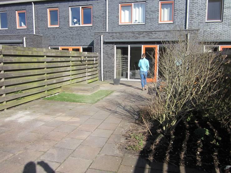 Situatie voor de renovatie:  Tuin door Van Dijk Tuinen Groningen