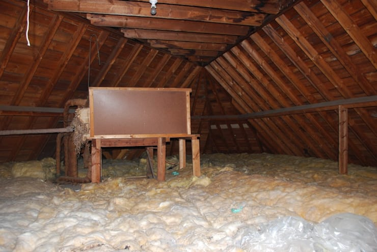 The attic prior to conversion:   by Loft Architect