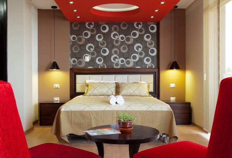 suite:  de estilo  por diseño integral y construcción sac, Moderno