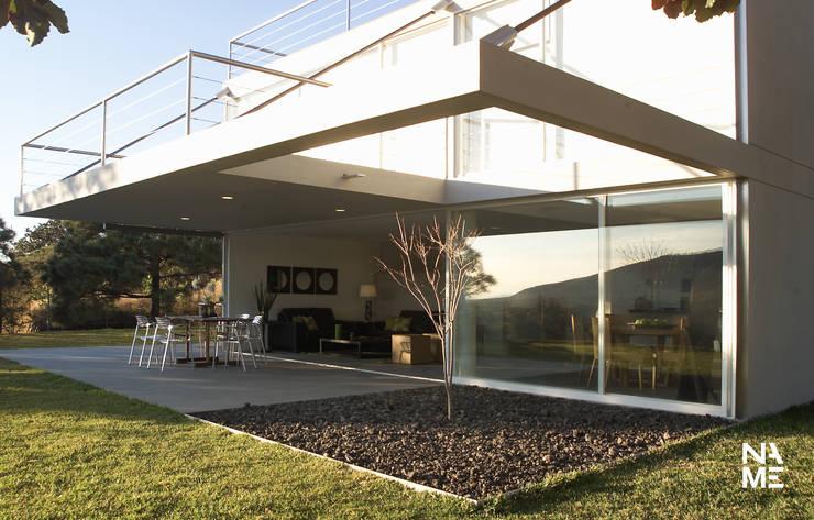 JARDIN: Casas de estilo  por NAME Arquitectos