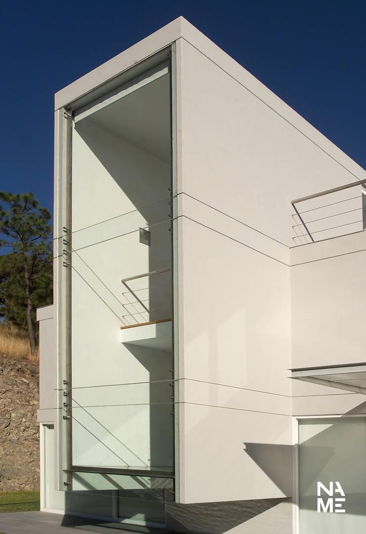 VOLUMETRIA: Casas de estilo  por NAME Arquitectos